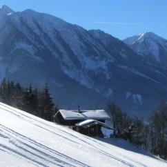 Art Chalet Vorderschuhzach im Winter mit Blick nach Süden zu den Hohen Tauern